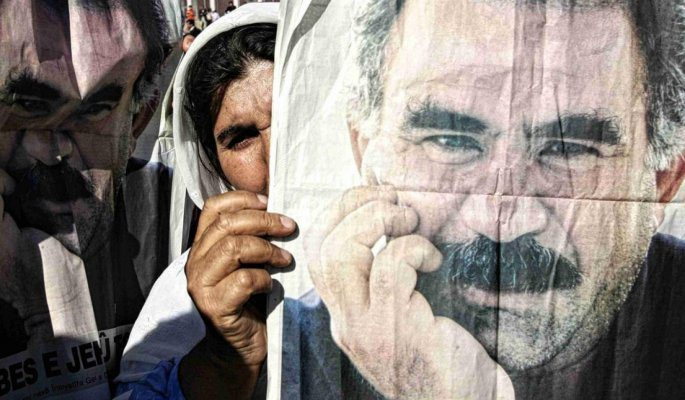 A kurdish woman holds a poster of abdullah ocalan at a protest in silopi near the turkish iraq border i november 2007 (afp)